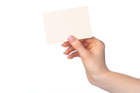 Photo pour Womans hand with blank white business card isolated on white - image libre de droit