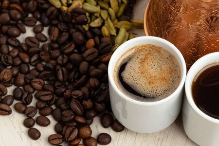 Photo pour Cup of coffee with roasted beans, seeds and cinnamon - image libre de droit