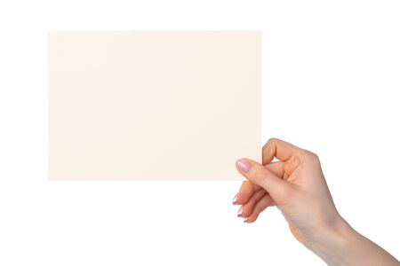 Photo for Woman's hand holding blank white sheet of paper isolated on white background - Royalty Free Image
