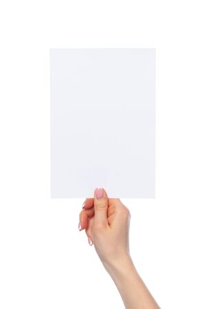 Photo for Female hand holding blank white sheet of paper isolated on white background - Royalty Free Image