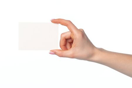 Photo pour Woman's hand with blank white business card isolated on white background - image libre de droit