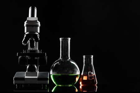 Photo pour laboratory microscope on table in the dark - image libre de droit