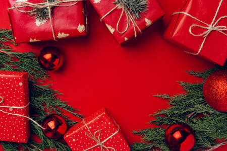 Photo for Red festive Christmas background with coniferous branches - Royalty Free Image