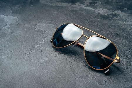 Photo pour New dark aviator glasses on grey concrete background - image libre de droit