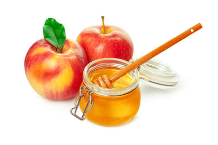 Photo for Apples and honey jar for jewish new year holiday isolated on white background. High quality photo - Royalty Free Image