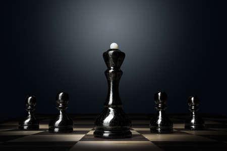 Foto de Chess board with figures on dark background - Imagen libre de derechos