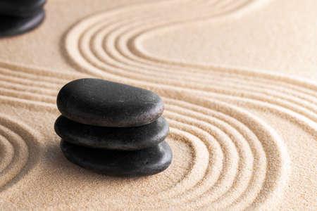 Photo pour Japanese zen garden with stone in raked sand - image libre de droit