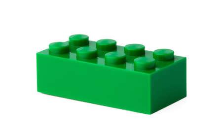 Photo pour Green plastic building block isolated on white - image libre de droit