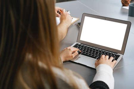 Photo pour Back view of unrecognizable woman typing on laptop - image libre de droit