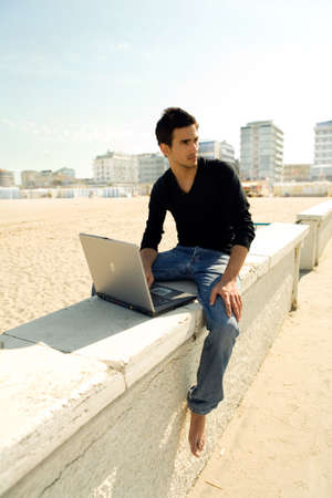 Attractive man with laptop outdoor