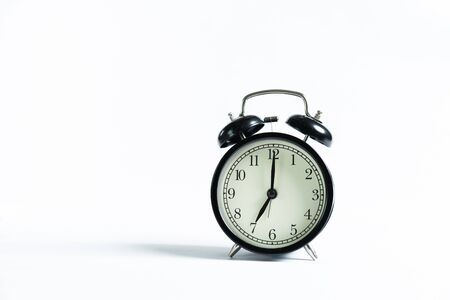 Photo for A black alarm clock isolated against white background - Royalty Free Image