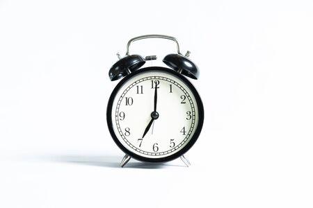Foto de A black alarm clock isolated against white background - Imagen libre de derechos