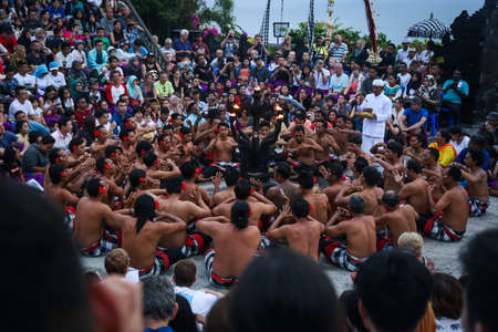 Photo pour The Kecak Fire Dance is one of Bali's most iconic art performances, famous for its dominant use of human vocals in place of gamelan instruments to accompany the dance. - image libre de droit