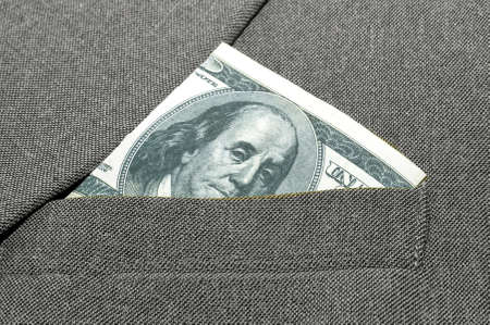 banknote in a breast pocket of a jacket.
