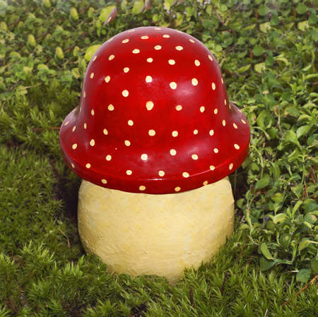 decorative mushroom a fly agaric in a green grass.