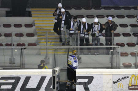ZELL AM SEE, AUSTRIA - OCT 1: Austrian Icehockey Classic Tournament. Fans challenging Guentner (Graz) in the penalty box. Game Grazer Oldies vs. West coast stars (Result 2-2).