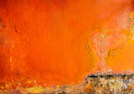 Old and dirty orange color painted on concrete wall texture background with space. Fungus on the house wall