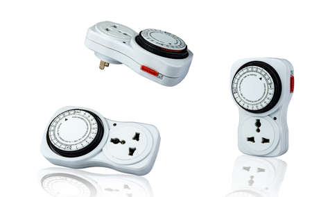 Plug-in timer mechanical 24 hour. Indoor home tools. Plug-in timer socket set isolated on white background. Mechanical outlet timer. Home security supply. Smart home tools. Mechanical timer switch.