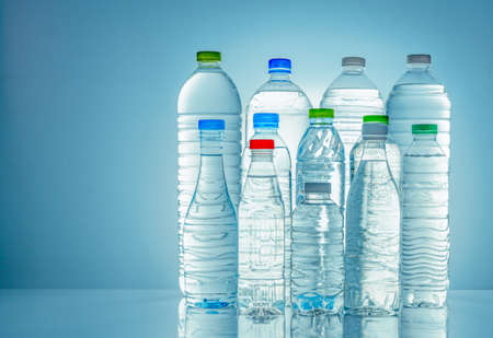 Photo for Set of transparent plastic water bottle with blank label. Clear water and natural mineral bottle with white, green, red, and blue cap. Healthy drink. Collection of plastic bottle with full liquid. - Royalty Free Image