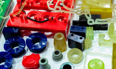 Photo pour Engineering plastics. Plastic material used in manufacturing industry. Global engineering plastic market concept. Polyurethane and abs plastic parts materials. Plastic injection machine products. - image libre de droit