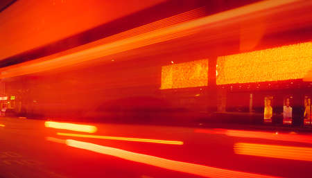 Photo for City street in the night with blurred fast speed car light. Red and yellow light at the rod beside the building. Night light abstract background. Blurred motion of light on the road. - Royalty Free Image