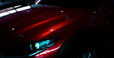 Photo pour Selective focus on  shiny red luxury SUV car in showroom. Elegant electric car with sport design. Car parked in showroom. Car dealership. Electric vehicle development concept. Future transportation. - image libre de droit