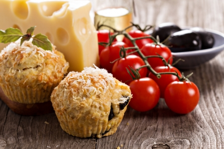 Savoury muffins with parmesan cheese and olives