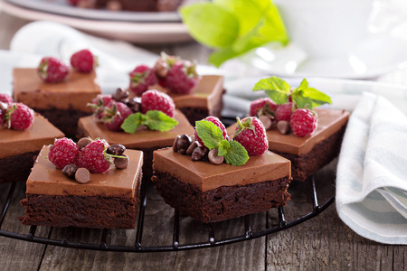 Chocolate mousse brownies with raspberry on a cooling rack