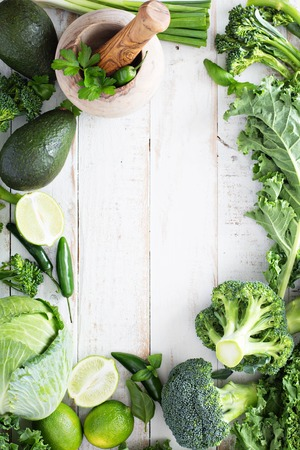 Foto für Green fresh fruit and vegetables copy space on white table - Lizenzfreies Bild