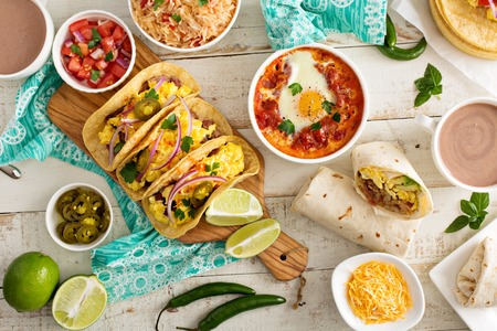 Photo pour Variety of colorful mexican cuisine breakfast dishes on a table - image libre de droit