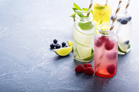 Photo pour Variety of cold drinks in small bottles - image libre de droit
