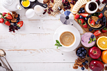 Photo for Bright and colorful breakfast ingredients on white table - Royalty Free Image