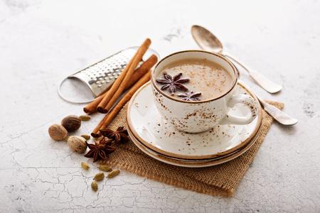 Photo pour Masala tea in ceramic cup with winter spices - image libre de droit