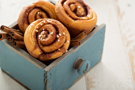 Cinnamon buns freshly baked in a wooden box