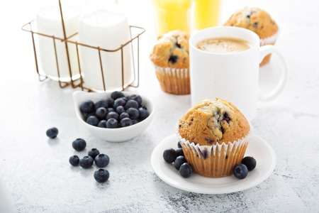 Photo for breakfast with blueberry muffin, big cup of coffee and milk in bottles - Royalty Free Image