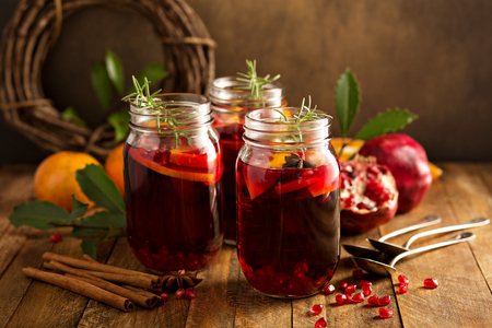 Photo pour Pomegranate and orange winter or autumn cocktail, punch or sangria in mason jar - image libre de droit