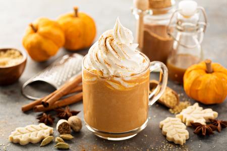 Pumpkin spice latte in a glass mug