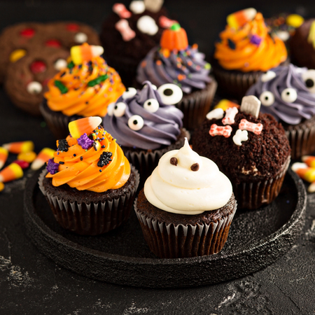 Photo for Festive Halloween cupcakes and treats - Royalty Free Image
