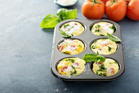 Healthy egg muffins, mini frittatas with tomatoesの写真素材