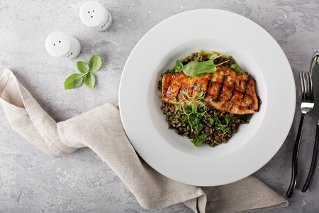 Photo pour Grilled salmon with lentils and swiss chard - image libre de droit