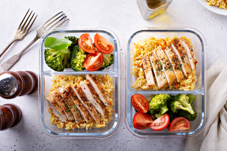 Healthy meal prep containers with chicken, rice and vegetables
