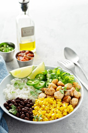 Photo for Chipotle spicy chicken with rice corn, beans - Royalty Free Image