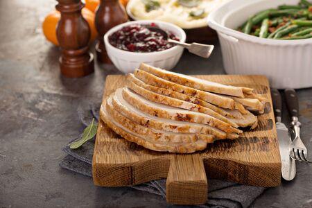 Photo pour Sliced turkey on Thanksgiving or Christmas table - image libre de droit