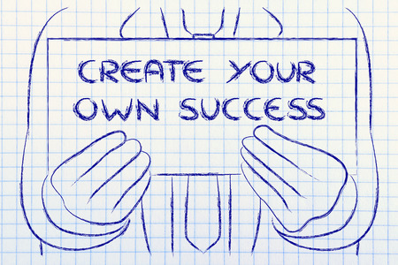Create your own success, sign in the hands of a business man