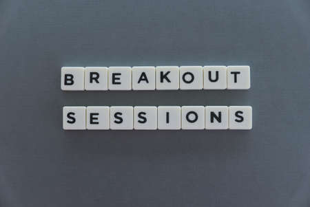 Photo pour Breakout Sessions word made of square letter word on grey background. - image libre de droit