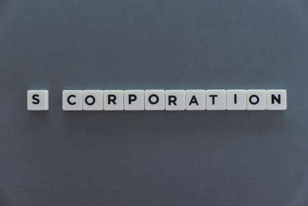 Foto de S Corporation word made of square letter word on grey background. - Imagen libre de derechos