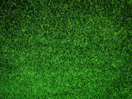 Foto de Closeup view of green grass soccer field background. Wallpaper for work and design. - Imagen libre de derechos
