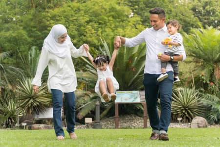 Foto de Malay family at recreational park having fun - Imagen libre de derechos