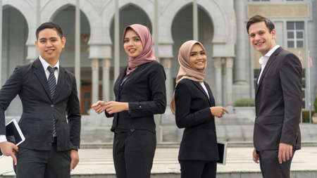 Photo pour A group of young mixed Asian Executive at the wearing suit standing and smile to camera - image libre de droit