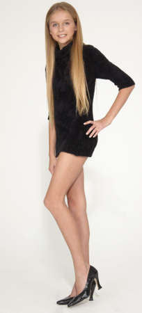 Photo for Long Legged Slim Blond Teen in a Short Dress and Heels - Royalty Free Image